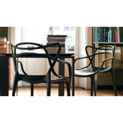 Black Masters Chairs at Table by Philippe Starck for Kartell Table