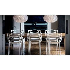 Dining Room with White Masters Chairs by Philippe Starck for Kartell