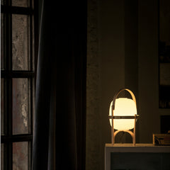 Miguel Milá Cestita Table Lamp at Night on Table by Santa & Cole