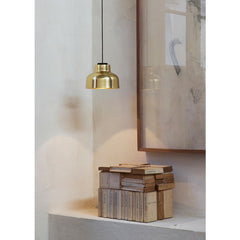 Miguel Milá M64 Polished Brass Suspension Lamp over Books by Santa & Cole