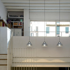 Miguel Milá M64 Polished Aluminum Suspension Lamps in Stairwell by Santa & Cole