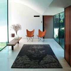 NaniMarquina Milton Glaser African Pattern Rug with Shakespeare's face in situ with Butterfly chairs