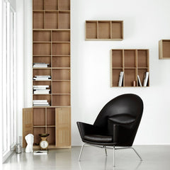 Mogens Koch cabinet and bookcases in room with Wegner Oculus Chair Carl Hansen and Son