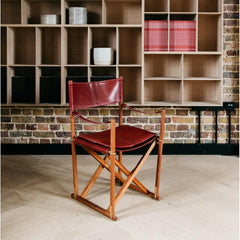 Mogens Koch Folding Chair in Burgundy Leather in room with bookshelves Carl Hansen and Son