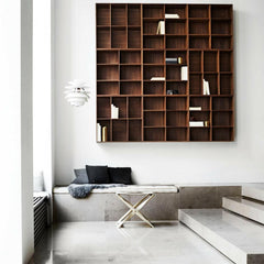 Mogens Koch Bookcase in Walnut wall mounted in room with Kaare Klint Propeller Stool