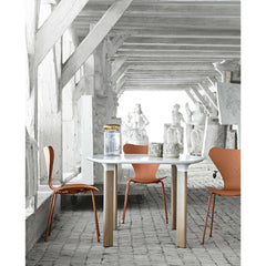 Chevalier Orange Monochrome Series 7 Chairs in Room with Analog Table Arne Jacobsen Fritz Hansen