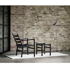 Black Wegner CH44 Chair with White Naja Utzon Popov Woodlines Rug Carl Hansen and Son