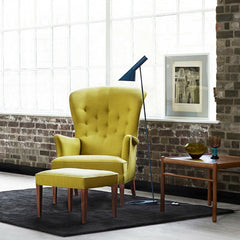 Naja Utzon Popov Woodlines Rug Black with Black Lines in Room with Yellow Frits Henning Heritage Chair Carl Hansen and Son
