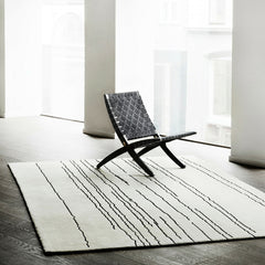 Woodlines Rug White with Black Lines in Room with Black Cuba Chair Carl Hansen & Son
