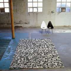 Nani Marquina Manuscrit Rug by Joaquim Ruiz Millet Black and White in Room