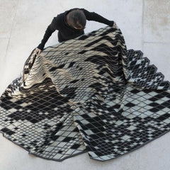 Nani Marquina Losanges Rug Black and Ivory being unfolded