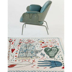 Nani Marquina Hayon x Nani Rug in room with chair