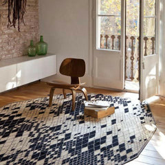 Nani Marquina Losanges Rug II in room with Eames Chair