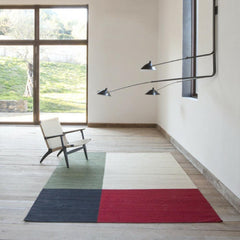 Nani Marquina Melange Rug Color 1 in Room with Wegner CH25 Chair and Serge Mouille Lamp