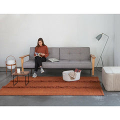 Nani Marquina Mia Rug Pouf in Stone with Mia Rug Brick in Room with Cestita and Grasshopper Lamps