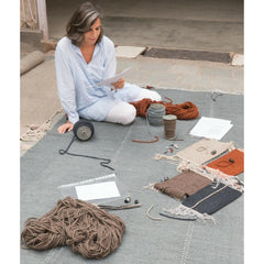Nani Marquina studying materials for Mia rug collection