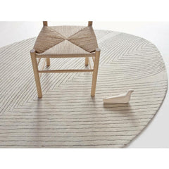Nani Marquina Quill Rug Large with Hans Wegner stool and Bouroullec L'oiseau