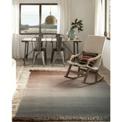 Nani Marquina Shade Rug Palette 4 Stormy Grey Sunset in room with rocking chair and Tolix chairs