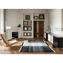 Nani Marquina Tres Rug Black in Room