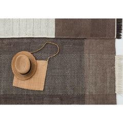 Nani Marquina Tres Rug Chocolate Detail with straw hat