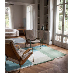 Nani Marquina Tres Rug Green in room