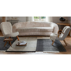Nani Marquina Tres Rug in Room with Polar Bear Sofa