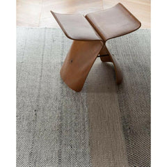 Nani Marquina Tres Rug in room with Sori Yanagi Butterfly Stool