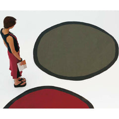 Nanimarquina Round Aros Rugs with Woman