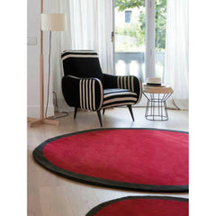 Nanimarquina Round Aros Rugs in room with Gio Ponti Chair