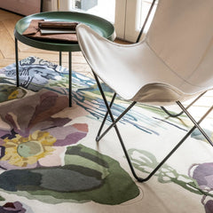 Nanimarquina Flora Backyard Rug by Santi Moix in room with Butterfly Chair