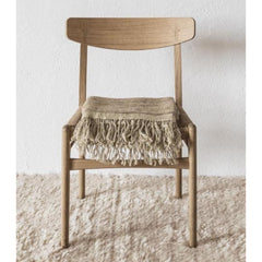 Nanimarquina Ilse Crawford Wellbeing Wool Chobi Rug in room with Throw and Wegner CH23 Chair