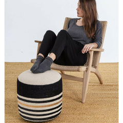 Nanimarquina Kilim Pouf 2 in room with girl in Wegner CH25 Chair
