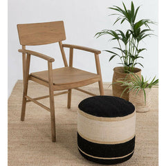 Nanimarquina Kili Pouf 1 in room with wood chair