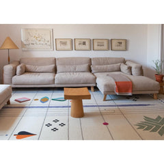 Nanimarquina Rabari rug by Doshi Levien in living room with sectional sofa