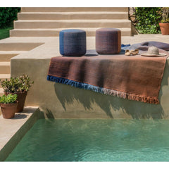 Nanimarquina Shade poufs and rug by pool