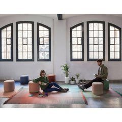 Nanimarquina Shade Rugs and Shade Poufs in loft with people