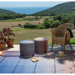 Nanimarquina Shade Poufs and Rug in situ outdoors
