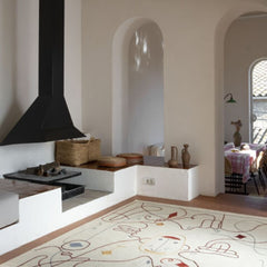 Nanimarquina Silhouette Rug by Jaime Hayon by Fireplace.