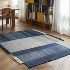 Nanimarquina Tres Rug Blue in room with Prouve Standard Chair