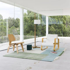 Nanimarquina Tres Rug Green in room with Eames and Alvar Aalto Chairs