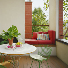 Noguchi Cyclone Table Outdoors with Bertoia Chairs