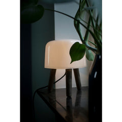 Norm Architects Milk Table Lamp with Light on a Table