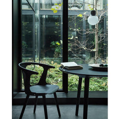 Norm Architects NA5 Mass Pendant Light Black Marble in room with Trestle Table