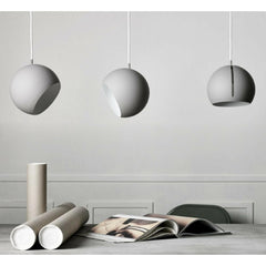 Nyta Tilt Globe Pendants Grey in Conference Room