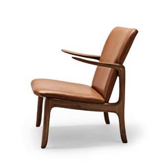Ole Wanscher Beak chair in cognac leather with walnut frame side view Carl Hansen and Son