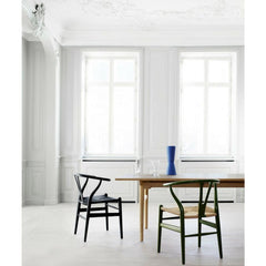 Wegner Wishbone Chairs Olive Green and Black in Room with Wegner Dining Table