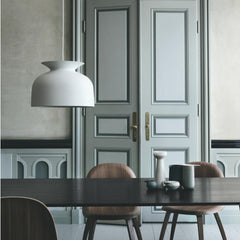 GUBI Large Matte White Ronde Pendant by Oliver Schick in room with 2D Dining Chairs by Komplot Design