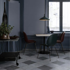 Paavo Tynell's 1965 Pendant with Bistro Green Shade, Beetle Dining Chairs, Gubi 1.0 Squared Dining Table, Matégot Trolley, and Adnet Circular Wall Mirror by GUBI