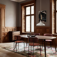 Paavo Tynell's A1965 Pendant with Coco Chairs, Gubi Eliptical Dining Table, and 62 Dresser by GUBI