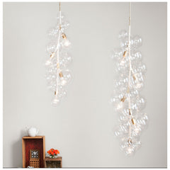 PELLE Tall Bubble Chandeliers in situ